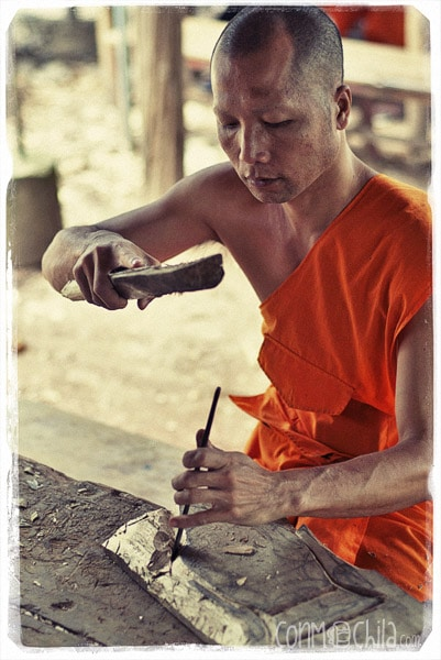 Monk carving wood at Wat Xieng Muan