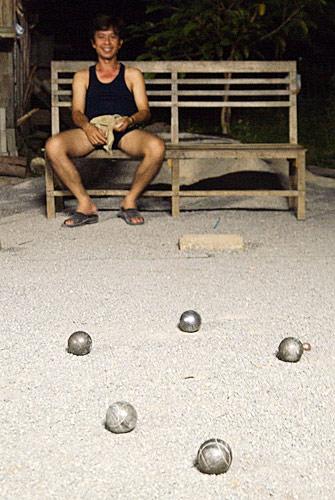 Jugador de petang en Laos